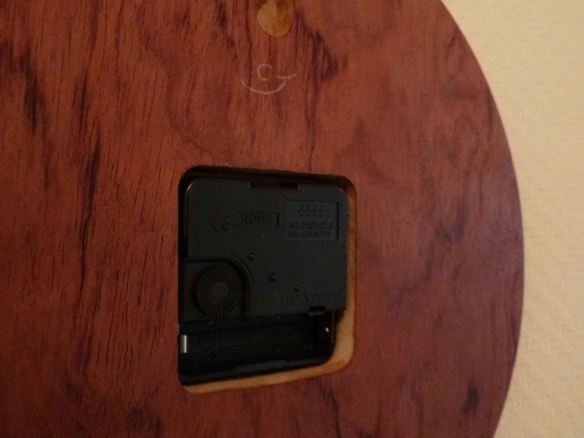 Pendule ronde en palissandre - vue 4
